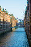 Canal in the historic Speicherstadt warehouse district in the ci Stock Image