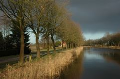Canal in Holland. Canal in the North-east of Holland Stock Photo
