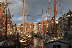 Canal in Holland. Classic sailing ships at a sailing event in an old harbor in Holland Stock Photography