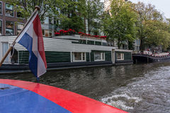 Canal House Boat with Dutch Flag Stock Image