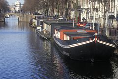 Canal and houseboats in Amsterdam, Holland Royalty Free Stock Images