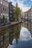 The canal houses along the junction of the canal Oudezijds Achte Stock Photography