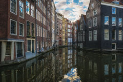 The canal houses along the junction of the canals Oudezijds Voor Stock Photos