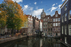 The canal houses along the junction of the canals Oudezijds Voor Royalty Free Stock Image