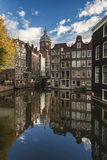 The canal houses along the junction of the canals Oudezijds Voor Royalty Free Stock Photos