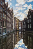 The canal houses along the junction of the canals Oudezijds Voorburgwal and Oudezijds Achterburgwal Stock Photos