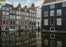 The canal houses along the junction of the canals Oudezijds Voorburgwal and Oudezijds Achterburgwal Royalty Free Stock Images