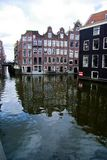 Canal with houses in Amsterdam Royalty Free Stock Photo