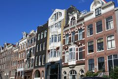 Canal houses in Amsterdam. Traditonal dutch houses lining one of the canals in Amsterdam Royalty Free Stock Photo