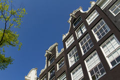 Canal houses in Amsterdam. Canal houses with a blue sky in the center of Amsterdam in the Netherlands royalty free stock photos