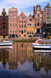 Amsterdam scene. Canal houses of Amsterdam, Netherlands with reflections Stock Photo