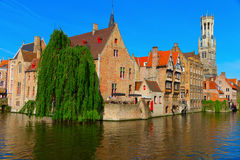 Canal and houses at Bruges, Belgium. View of canal, belfry and houses at Bruges, Belgium Royalty Free Stock Photography