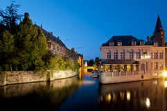 Canal houses of Bruges by night, Belgium. Typical houses besides a canal Bruges, Belgium Royalty Free Stock Photo