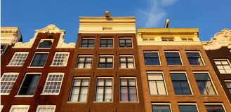 Canal houses facade in The Netherlands stock photography