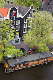 Canal Houses and Houseboat in Amsterdam Stock Photography