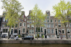 Canal houses on leidsegracht in centre of amsterdam with green t. Facades of canal houses on leidsegracht in centre of amsterdam with green trees in spring Stock Image