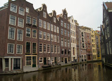 Canal between the houses. Narrow the canal flowing between the houses Royalty Free Stock Image