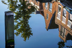 Canal houses seen in reflection of water Stock Image
