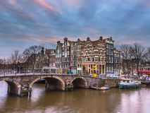 Canal houses sunset Amsterdam Royalty Free Stock Images