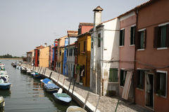 Canal the island of Burano. Colorful houses on the island of Burano in the Venetian lagoon - Italy Royalty Free Stock Photography