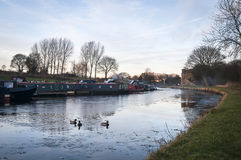 Canal Life. A winter image of Narrowboats moored at Barnoldswick marina on the Leeds and Liverpool canal in Lancashire Royalty Free Stock Photo
