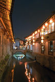 Canal in Lijiang. A canal running through the old town of Lijiang lit by the romantic light of Chinese lanterns stock photography