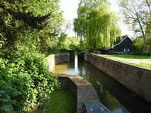 Canal and lock in Bornem. A canal with water lock in Bornem, Belgium Royalty Free Stock Photos