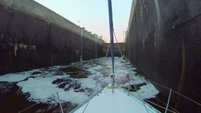 Canal lock filling with dirty water. Boats, transport, industry. Stock footage stock footage