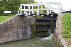 Canal lock with footbridge, Kennett and Avon Canal. Royalty Free Stock Photo