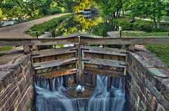 Canal lock on historic C&O Canal waterway. A working canal lock on the C&O Canal National Park waterway at Great Falls, MD, with a working replica canal Stock Photo