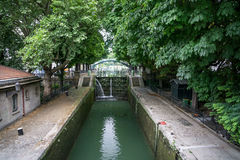 Canal Lock i Paris. Canal lock in the Saint-Martin canal in Paris France Stock Images