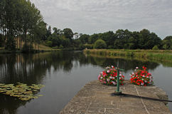 Canal Lock on the Nantes to Brest Canal. Floral Canal Lock on the Nantes to Brest Canal Stock Images