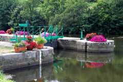 Canal Lock on the Nantes to Brest Canal. Floral Canal Lock on the Nantes to Brest Canal Stock Photos