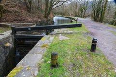 Canal lock, Neath  Canal. Closed single gate lock. Resolven Basin, Neath Canal. Resolven, Vale of Neath, Port Talbot, Wales, United Kingdom Royalty Free Stock Photo