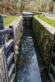 Canal lock, Neath  Canal. Closed single gate lock. Resolven Basin, Neath Canal. Resolven, Vale of Neath, Port Talbot, Wales, United Kingdom Stock Photos