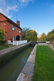 Canal lock next to keeper's cottage Stock Photo