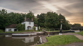 Canal Lock. Old Lock Cottage in England Royalty Free Stock Photos