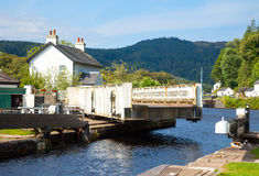 Canal lock with swing bridge. Canal Lock at Cairnbaan Bridge on the Crinan Canal in Scotland Royalty Free Stock Photos