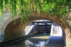 Canal lock through a tunnel Stock Image
