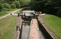 Canal locks. Pleasure craft going through canal locks Stock Image