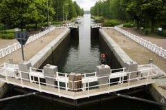 Canal locks with a jet ski Stock Photo