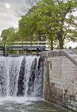 Canal locks. A lock is a device for raising and lowering boats between stretches of water of different levels on river and canal waterways Stock Photo