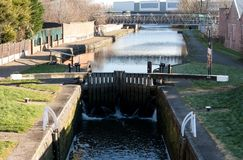 Canal Locks in Wigan Lancashire. The view down to the locks on the Leeds Liverpool canal in Wigan Royalty Free Stock Images