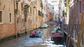 Canal with moving motorboat in Venice stock video