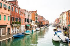 Canal in Murano island, street and boats Royalty Free Stock Photos