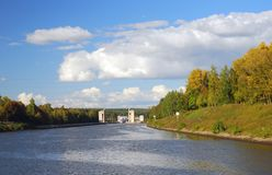 Canal named after Moscow, Russia. Lock on the canal. Autumn nature. Blue sky with clouds background. Still water. The Canal named after Moscow Moskva channel Royalty Free Stock Image