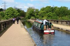 Canal narrow boat, Lune Aqueduct, Lancaster Canal Stock Images