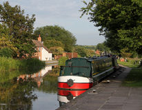Canal narrow boat in tranquil scene. Canal boat on a tranquil scene on the chesterfield canal UK stock photos