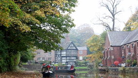 Canal narrow boats in autumn stock video