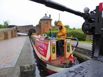 Canal narrowboat inside lock on rainy day Stock Photo